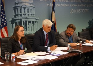 Leah Curtsinger, CACI; Bob Schlue, Boeing; and Ray Johnson, IBM, discuss issues with the CACI Federal Affairs Council.
